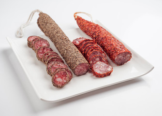 Spanish sausage on white tray