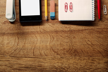 Office Supplies and Phone on Table at Top Edge