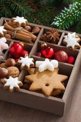 box with Christmas symbols on a wooden table, vertical, close-up