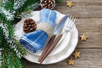 Christmas table setting on a wooden background, horizontal