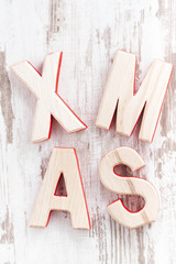 decorative wooden letters xmas on a white background
