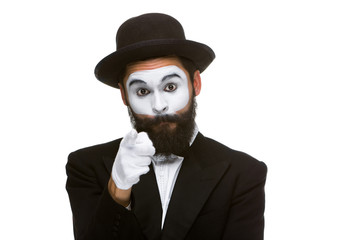 Portrait of mime with pointing finger