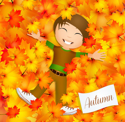 child on leaves in autumn