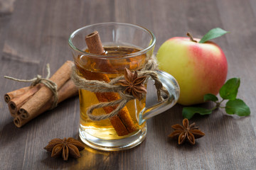 spiced apple cider and spices on a wooden table