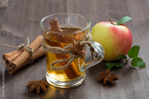 canvas print picture spiced apple cider and spices on a wooden table
