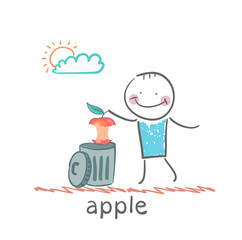 man throws an apple to eat in the trash