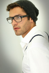 Trendy guy with suspenders and eyeglasses, isolated