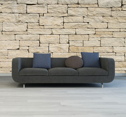 Comfortable grey sofa with a textured stone wall
