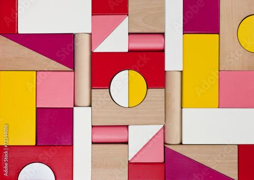 Background of multicolor wooden children toy blocks © didecs