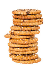 Stack of round cookies with sesame and flax seeds