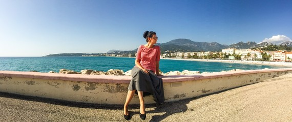 french riviera panorama with beautiful brunette in the middle