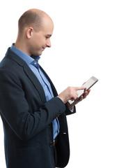handsome bald man using a digital tablet