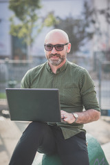 handsome middle aged man using notebook