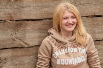 Portrait of green-eyed blonde girl wearing sweater