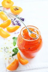 Homemade delicious apricot jam on a white background