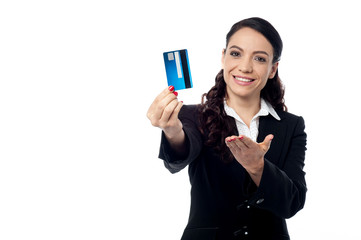 Young woman showing a credit card