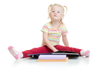 Funny kid in eyeglases reading book isolated on white