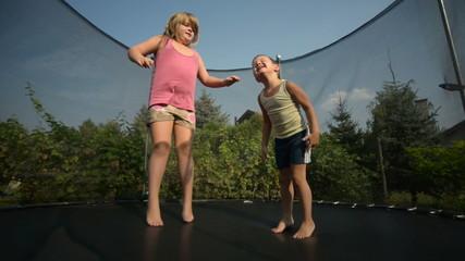 Children enjoy jumping on trampoline