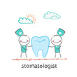 stomatologist examining patient tooth