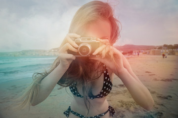 Sensual lady at the beach taking a picture