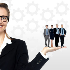 Business people standing on palm