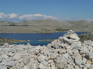 A cairn is a man made stack of stone in the Kornati park