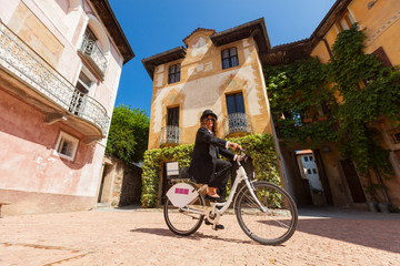 Woman on a bicycle through the streets of the country