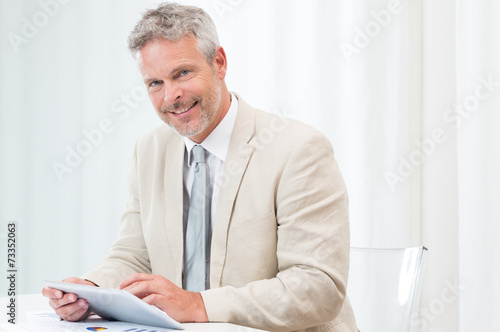 canvas print picture Happy Mature Businessman With Tablet