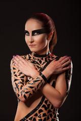 Beauty sexy girl in black tape dress, studio posed