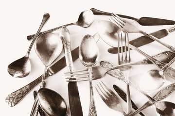 Old disordered tableware closeup