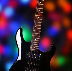 Guitar on bright background