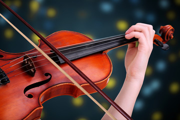 Beautiful young girl with classical violin on bright background