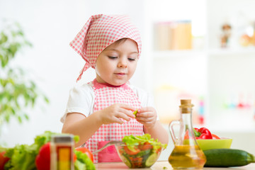cook kid girl preparing vegetables