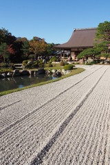 Rock garden texture with traditional Japanese house background