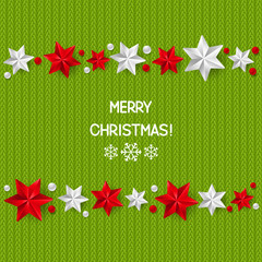Xmas starry decorations on green knitted background
