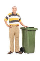 Senior standing by a trash can