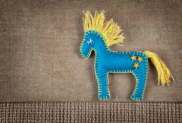 Blue horse toy with stars