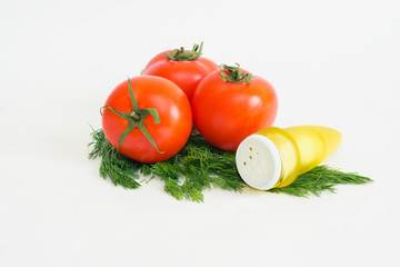 Tomatoes, dill and salt shaker