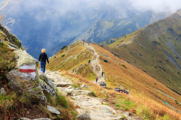 Group of tourists walking in the Tatra Mountains