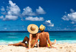 canvas print picture - Couple on a beach at Seychelles