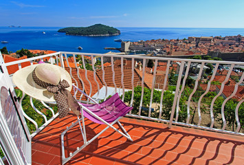 hat on chair in luxury balcony of Dubrovnik