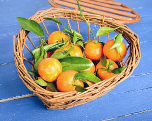 small basket full of mandarin oranges