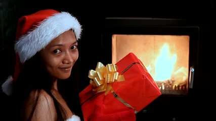 mrs. Claus throw Christmas gift into the fire in the stove