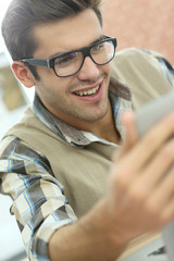 Young man with eyeglasses in training class