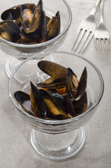 mussel with tomato sauce in a cocktail glass