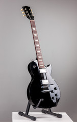 Electric guitar isolated on gray background