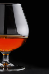Close-up of cognac on black background