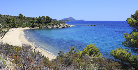 Pure white sand beach in the bay of Aegean Sea.