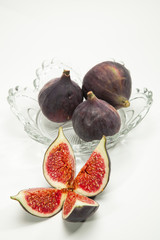 glass bowl with fresh figs isolated on white background