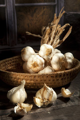 Organic garlic in a straw basket